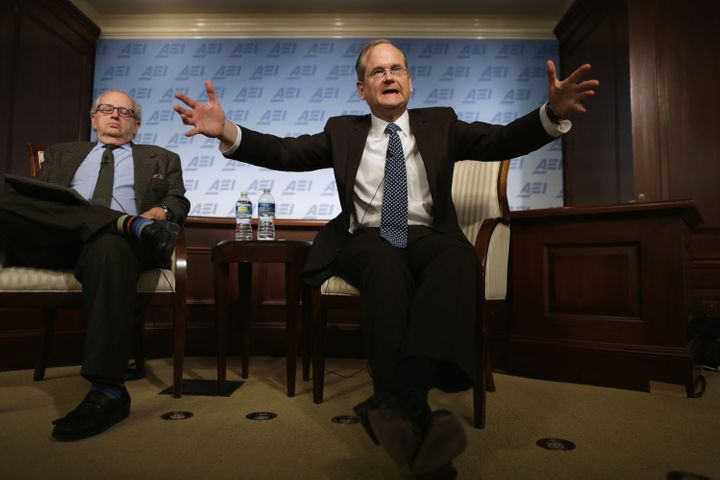 Harvard Law School professor and former 2016 Democratic presidential candidate Lawrence Lessig (right) discusses campaign fin