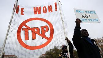 WASHINGTON, DC - NOVEMBER 14:  Activists shout slogans as they march during an anti-Trump and anti-TPP protest November 14, 2016 in Washington, DC. Activists held a rally and a march 'to protest the Trans-Pacific Partnership and urge President-elect Donald Trump and members of Congress to reject the trade deal.'  (Photo by Alex Wong/Getty Images)