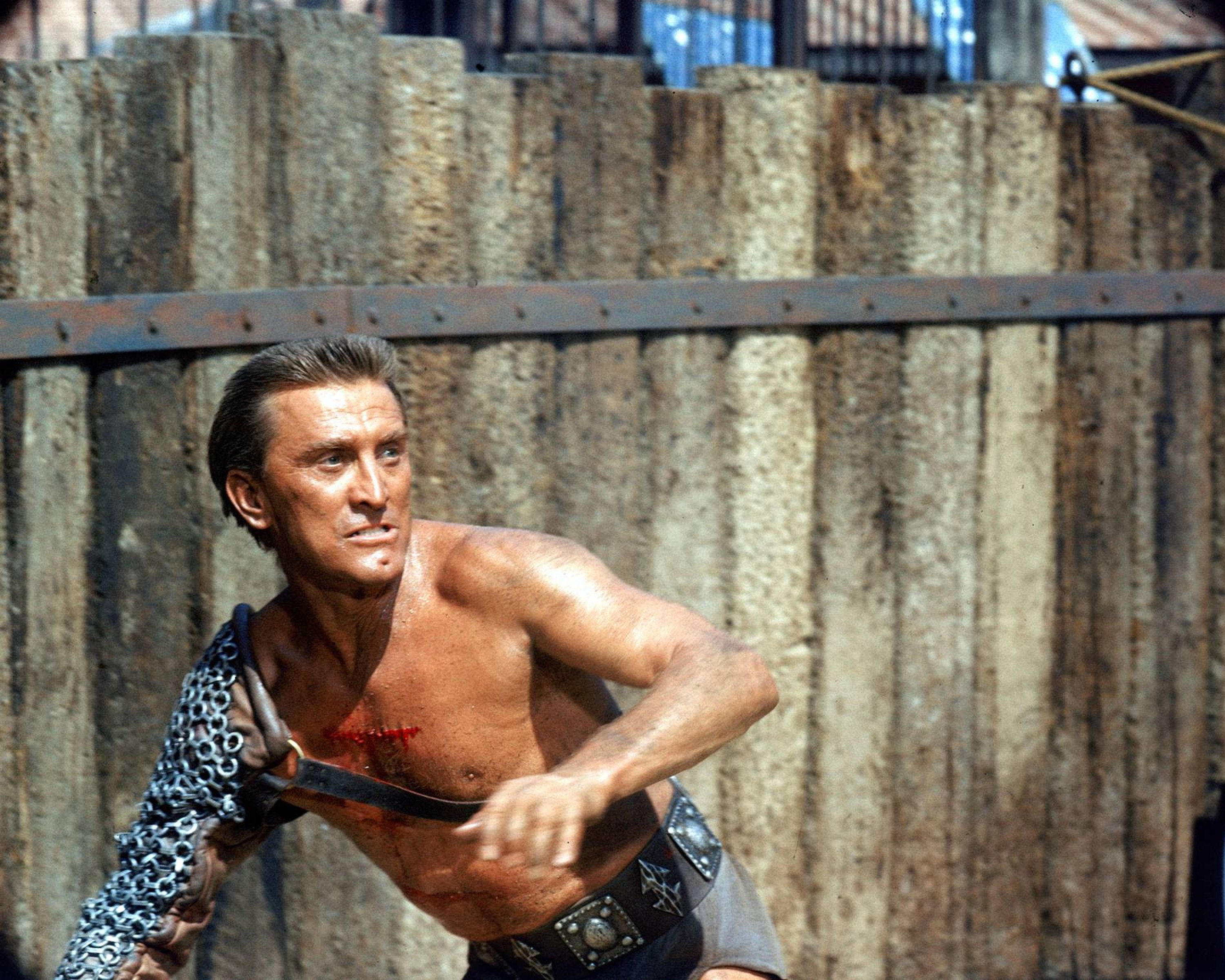Kirk Douglas, US actor, wearing chain mail protection on his right arm in a publicity still issued for the film, 'Spartacus', 1960. The historical drama, directed by Stanley Kubrick (1928-1999). starred Douglas as  'Spartacus', the leader of a Roman slave revolt. (Photo by Silver Screen Collection/Hulton Archive/Getty Images)
