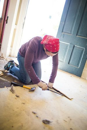 A volunteer works on renovations of the property that will house Encircle.