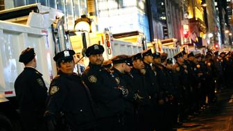NYPD Oficcers stand guard during in a protest against President-elect Donald Trump in New York on November 9, 2016. / AFP / KENA BETANCUR        (Photo credit should read KENA BETANCUR/AFP/Getty Images)