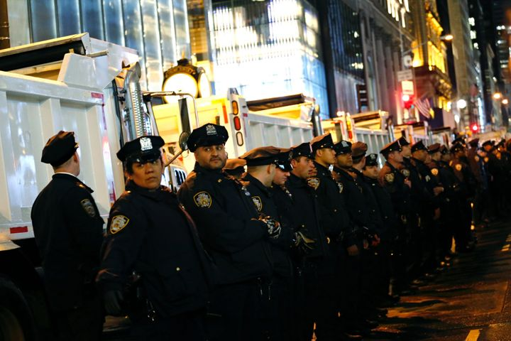 NYPD officers stand guard during a protest against President-elect Donald Trump in New York on November 9, 2016.