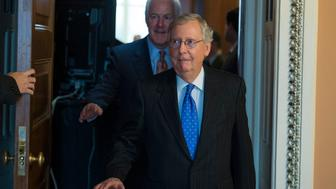 UNITED STATES - NOVEMBER 29: Senate Majority Leader Mitch McConnell, R-Ky., and Majority Whip John Cornyn, R-Texas, make their way to a news conference after the Senate Policy Luncheons in the Capitol, November 29, 2016. (Photo By Tom Williams/CQ Roll Call)