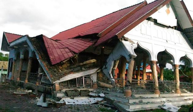 A badly damaged building is seen after a 6.5-magnitude earthquake struck the town of