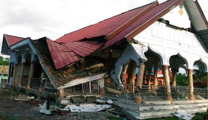 A badly damaged building is seen after a 6.5-magnitude earthquake struck the town of Pidie.