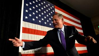 North Carolina Sen. Richard Burr calls staff to the stage for photos following his victory speech at the Forsyth Country Club in Winston-Salem, N.C., on Tuesday, Nov. 8, 2016. Burr defeated Democrat Deborah Ross. (Jeff Siner/Charlotte Observer/TNS via Getty Images)