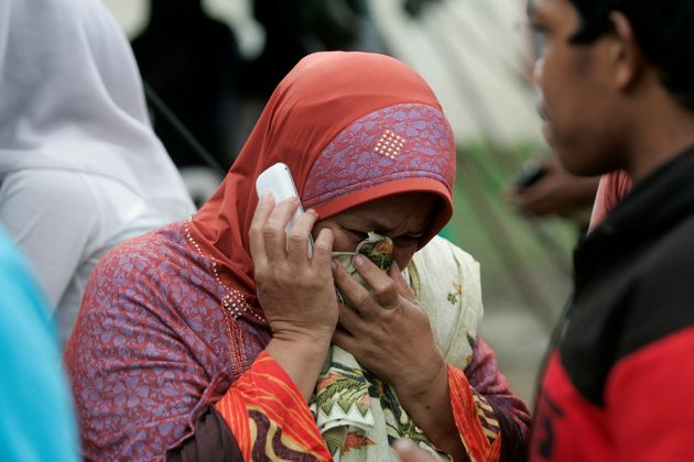 Relatives of the Injured people waiting outside a hospital in the quake-devastated area after an earthquake...