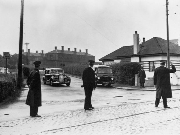 Magistrates cars are seen leaving Barlinnie Prison, Glasgow, after the execution of