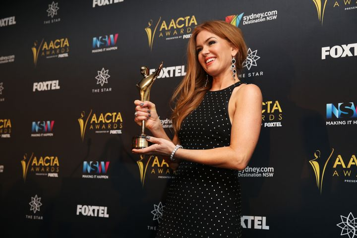 Isla Fisher poses in the media room after winning the Trailblazer Award at the 6th AACTA Awards Presented by Foxtel at The St