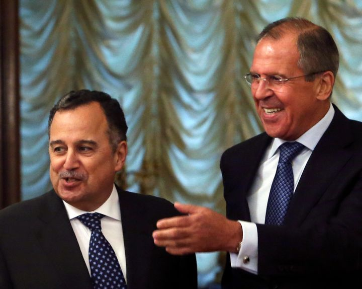 Russian Foreign Minister Sergei Lavrov, right, welcomes his Egyptian counterpart Nabil Fahmy during their meeting in Mos