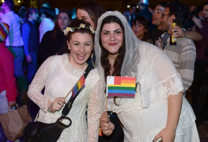 People celebrate in Saint George's Square after the Maltese parliament approved a civil unions bill in Valletta on April 14,