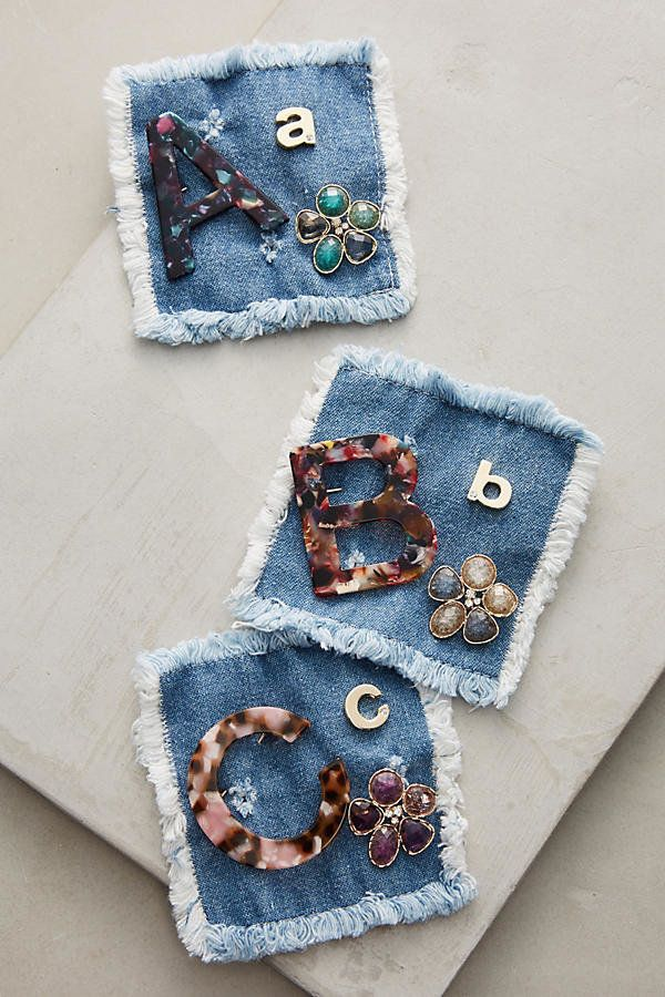 "Initial pin trio, $48, <a href=""https://www.anthropologie.com/shop/initial-pin-trio?category=SEARCHRESULTS&color=901"" tar"