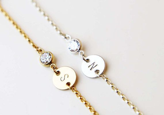 "Initial charm bracelet, $28, <a href=""https://www.etsy.com/listing/254693686/personalized-initial-disc-bracelet-with?ref=find"