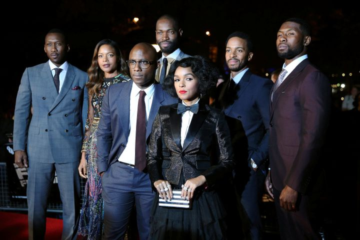 """Cast members pose as they arrive for the gala screening of the film """"Moonlight"""", on the second night of the 60th British Film"""