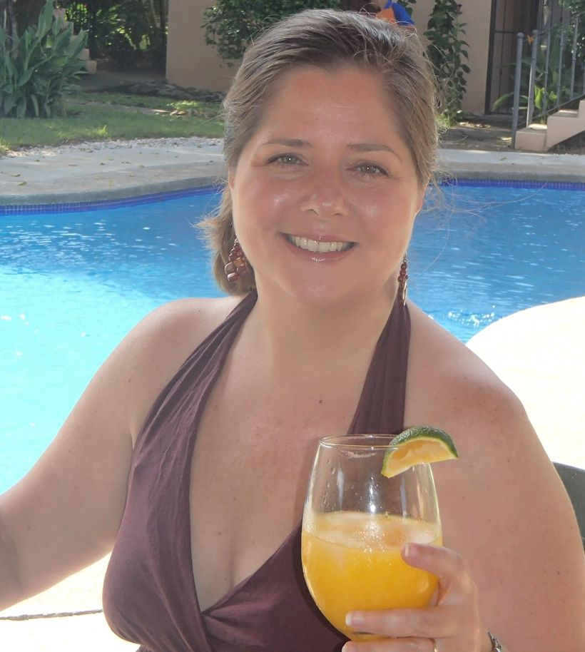 Working by the pool in Playa Coco, Costa Rica with some fresh orange-lime juice!
