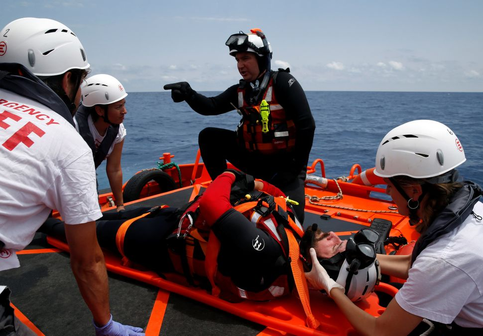 Rescuers with the Migrant Offshore Aid Station (MOAS) take part in a training exercise in order to respond to ships in distre