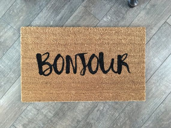 """$36.99, Nickel Designs Shop. <a href=""""https://www.etsy.com/listing/261760153/bonjour-welcome-mat-hand-painted?ga_order=most_r"""