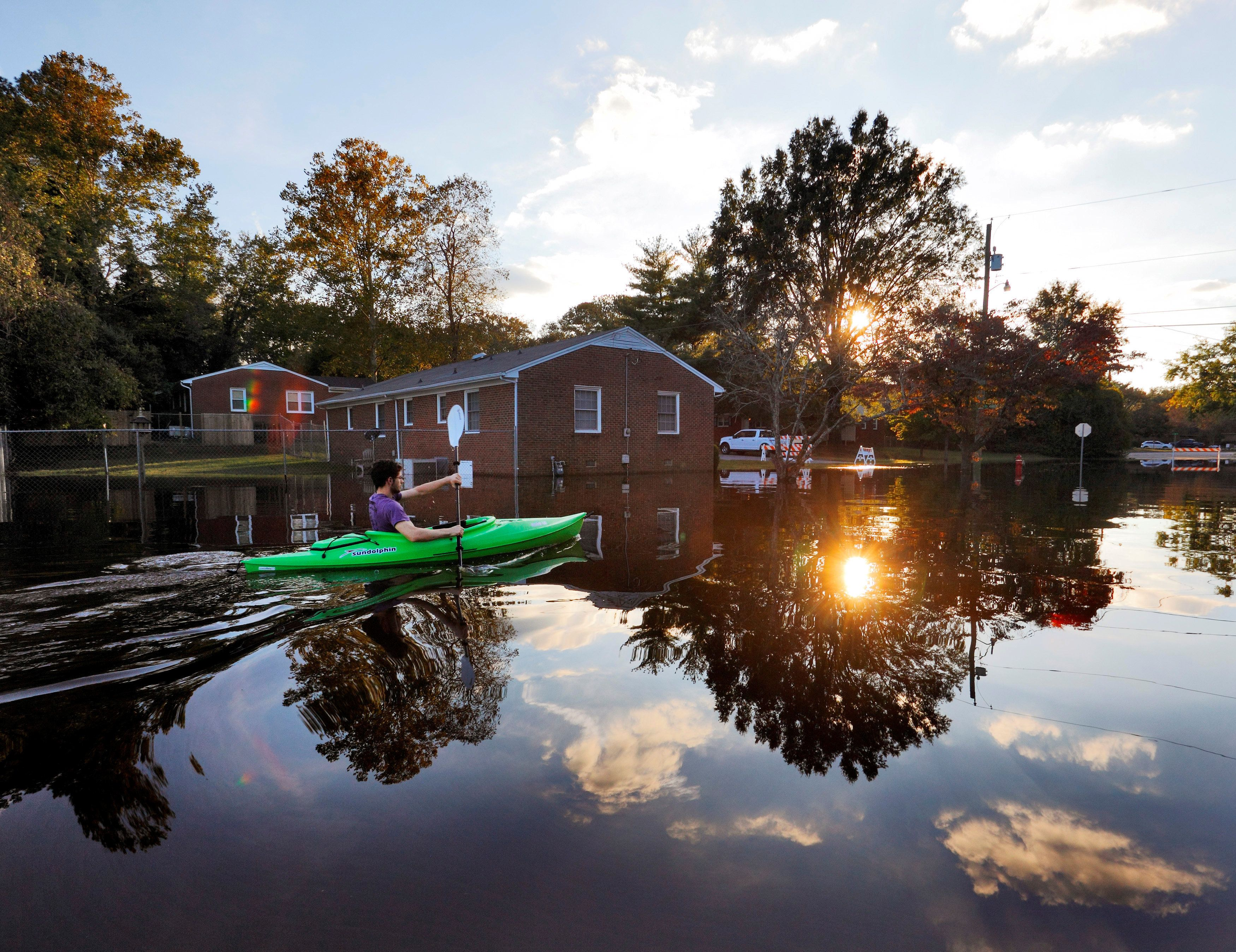A manpaddles his kayak in the aftermath of Hurricane Matthew -- an extreme weather event -- in Greenville, North Caroli