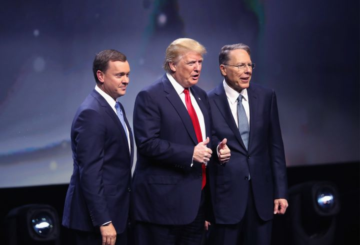 Republican presidential candidate Donald Trump is introduced with Chris Cox (L), Executive Director of the NRA Institute for