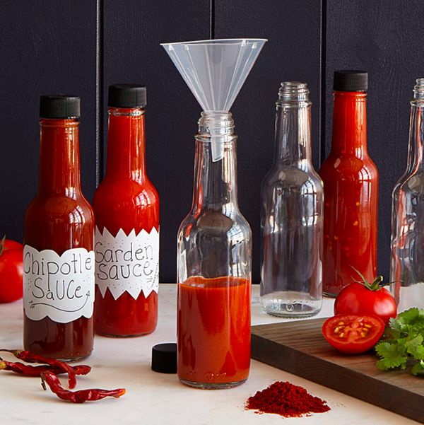 """<a href=""""http://www.uncommongoods.com/product/make-your-own-hot-sauce-kit"""" target=""""_blank"""">Make your own hot sauce kit</a>, $"""