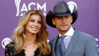 Singer Faith Hill and her husband Tim McGraw arrive at the 48th ACM Awards in Las Vegas April 7, 2013. REUTERS/Steve Marcus (UNITED STATES  Tags: Entertainment) (ACM-ARRIVALS)