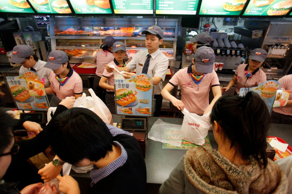 Diners eat at a KFC restaurant in Shanghai, China on Wednesday, Nov. 24, 2010.