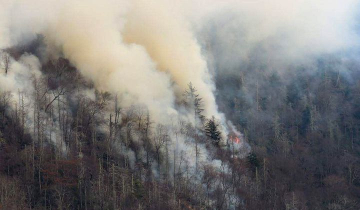 Smoke plumes from wildfires are shown in the Great Smoky Mountains near Gatlinburg, Tennessee, on Nov. 28, 2016.
