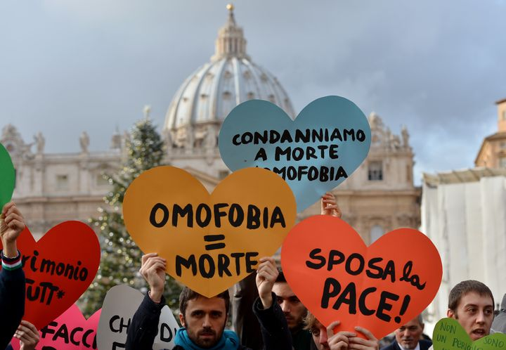 Italian gay rights activists demonstrate in front of the Vatican on December 16, 2012, to protest against Pope Benedict'