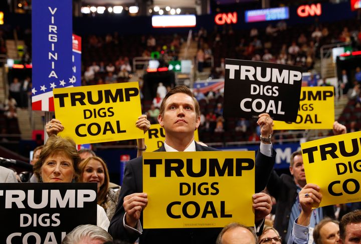 Delegates from West Virginia hold signs supporting coal on the second day of the Republican National Convention in Cleveland, Ohio, July 19, 2016.