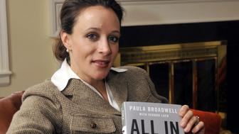 In this January 14, 2012 photo, Paula Broadwell, author of the David Petraeus biography 'All In,' poses for photos in Charlotte, North Carolina. Petraeus, the retired four-star general renowned for taking charge of the military campaigns in Iraq and then Afghanistan, abruptly resigned November 9, 2012 as director of the CIA, admitting to an extramarital affair. Petraeus carried on the affair with Broadwell, according to several U.S. officials with knowledge of the situation. (T. Ortega Gaines/Charlotte Observer/MCT via Getty Images)