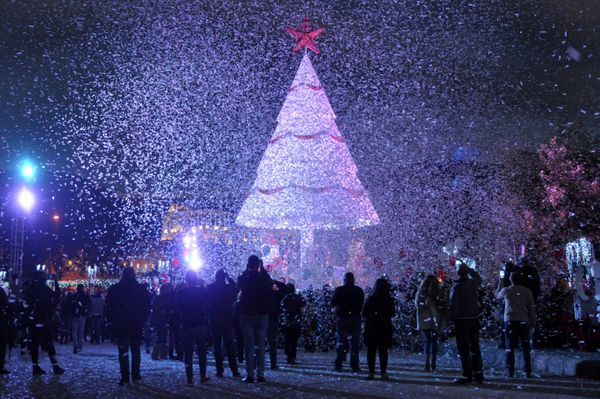 People gather under a Christmas Tree, marking the beginning of Christmas season in Zgharta city, north Lebanon December 3, 20