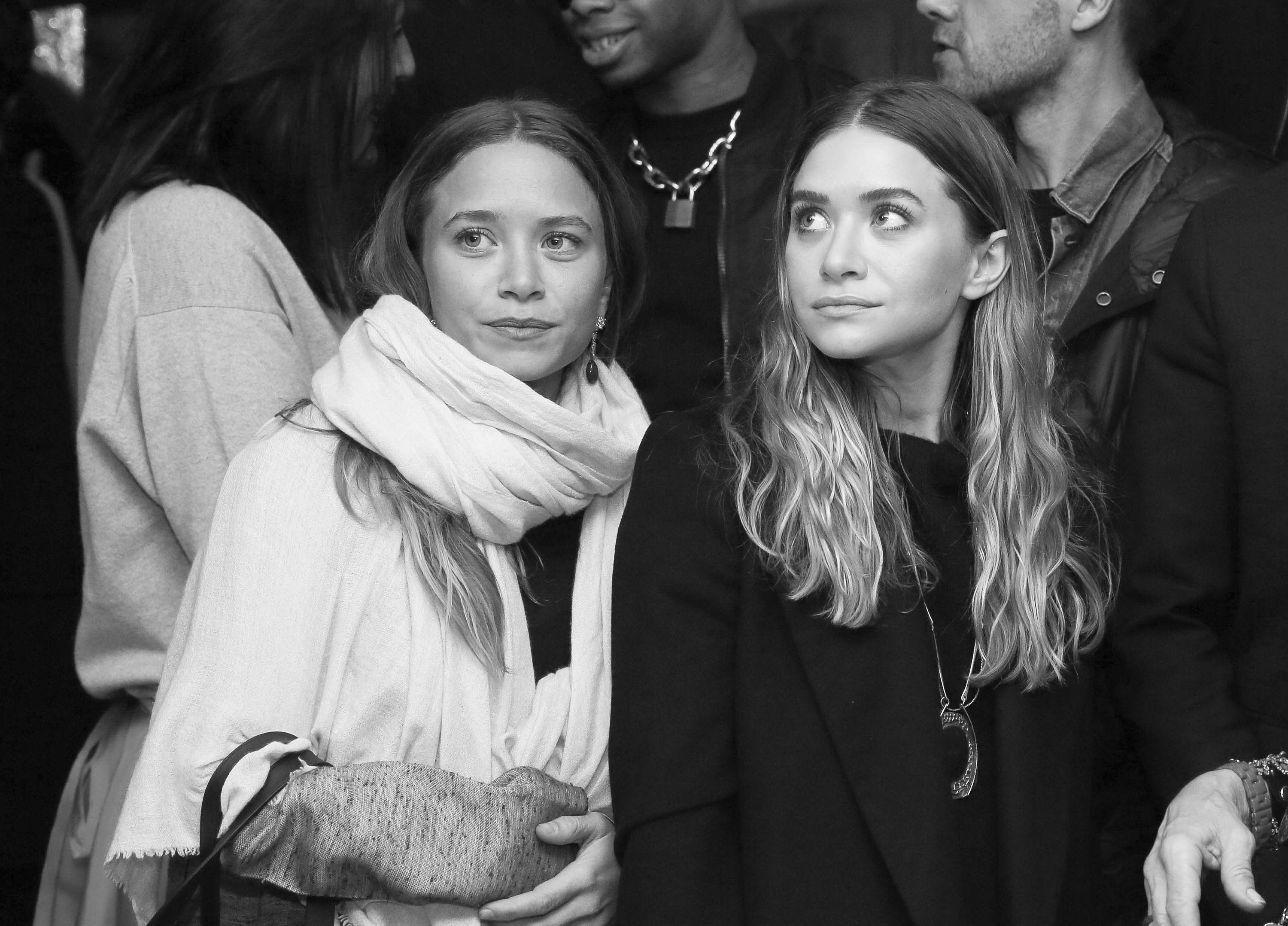 NEW YORK, NY - MARCH 16: (EDITORS NOTE: Image has been converted to black and white)  The Olsen Twins, Mary-Kate Olsen (L) and Ashley Olsen attend 2015 CFDA Fashion Awards Announcement Party at The Weather Room at the Top of the Rock on March 16, 2015 in New York City.  (Photo by Rob Kim/Getty Images)
