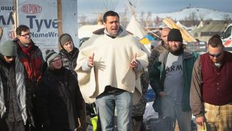 CANNON BALL, ND - DECEMBER 03: Wes Clark Jr., co-coordinator of #VeteransForStandingRock, briefs military veterans on camp rules and their mission at Oceti Sakowin Camp on the edge of the Standing Rock Sioux Reservation on December 3, 2016 outside Cannon Ball, North Dakota. As many as 2,000 veterans are expected at the camp this weekend to participate in non-violent protests against the construction of the Dakota Access Pipeline. Native Americans and activists from around the country have been gathering at the camp for several months trying to halt the construction of the pipeline. The proposed 1,172-mile-long pipeline would transport oil from the North Dakota Bakken region through South Dakota, Iowa and into Illinois.  (Photo by Scott Olson/Getty Images)