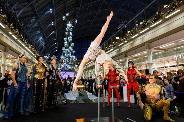 Artists from Cirque du Soleil perform as St Pancras Station unveils it's Cirque du Soleil 'Amaluna' Christmas tree on Novembe