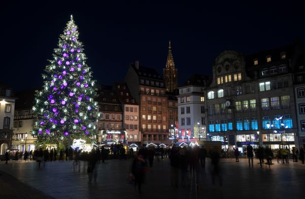 People walk near the Christmas tree during the traditional Christmas market, in Strasbourg, eastern France, on November 28, 2