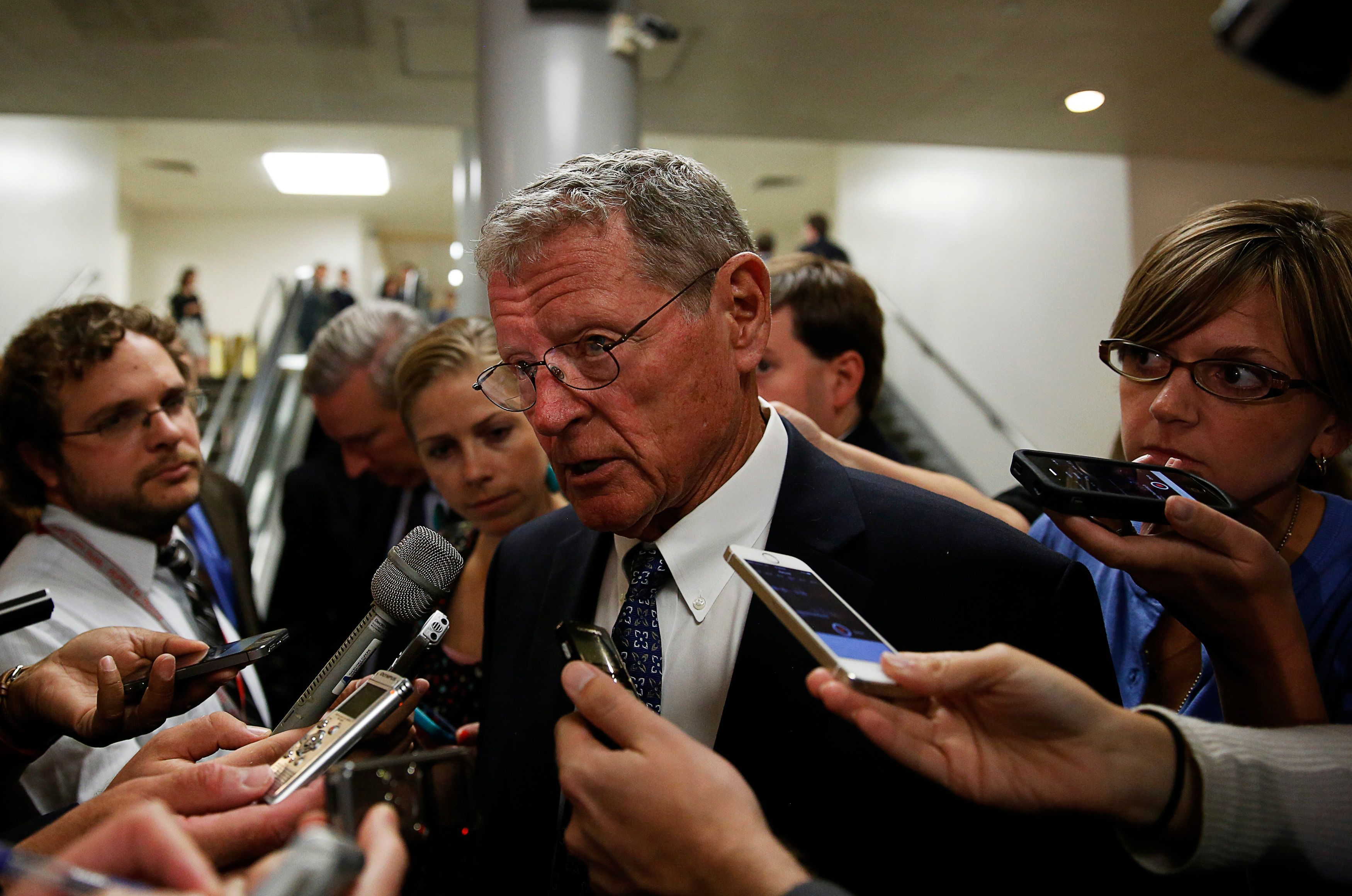 Senate Armed Services Committee ranking member Senator James Inhofe (R-OK) (C) talks to media after departing a closed hearing on Iraq and Afghanistan in Washington July 8, 2014.   REUTERS/Gary Cameron   (UNITED STATES - Tags: POLITICS MILITARY)