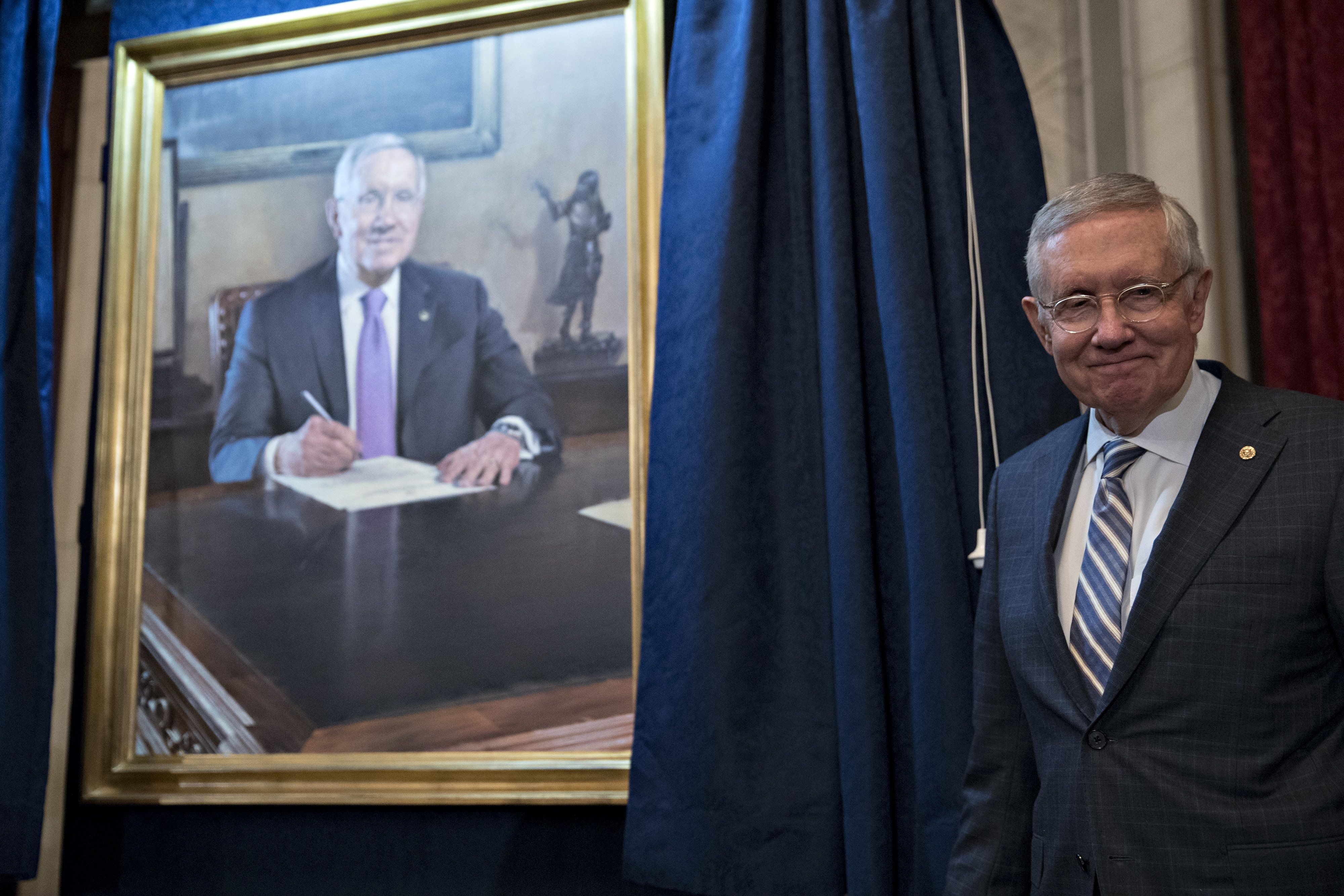 Senate Minority Leader Harry Reid, a Democrat from Nevada, stands next his official portrait during a ceremony on Capitol Hill in Washington, D.C., U.S., on Thursday, Dec. 8, 2016. Reid, the tart-tongued ex-boxer known for pugilistic rhetoric about Republicans, is marking the end of his 34-year career in Congress with the unveiling of his official portrait that was painted by former Senate staffer Gavin Glakas. Photographer: Andrew Harrer/Bloomberg via Getty Images