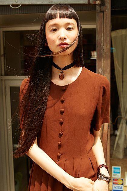 <p><em>Model's own dress and jewelry.</em></p>