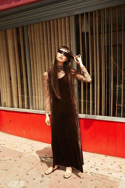 "<p><em>Model's own dress and jewelry;</em> <a rel=""nofollow"" href=""https://www.gucci.com/"" target=""_blank"">Gucci</a> <em>shoes.</em></p>"