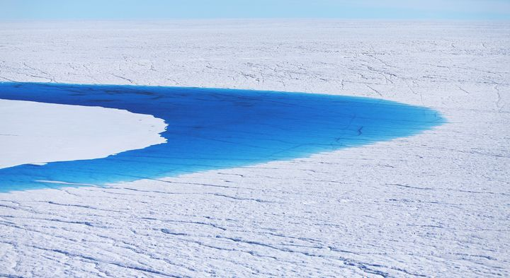 Water is seen on part of Greenland's glacial ice sheet, July 2013.