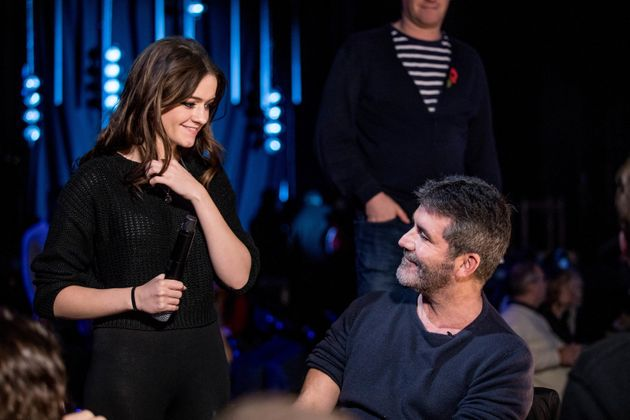 Simon Cowell with former contestant Emily