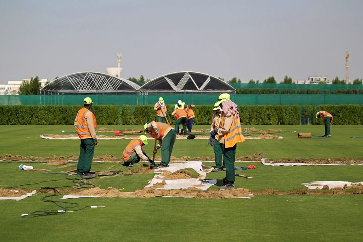 Workers test soil as they grow grass for Qatar's 2022 World Cup, at an experimental facility in Doha, Qatar November 29, 2016