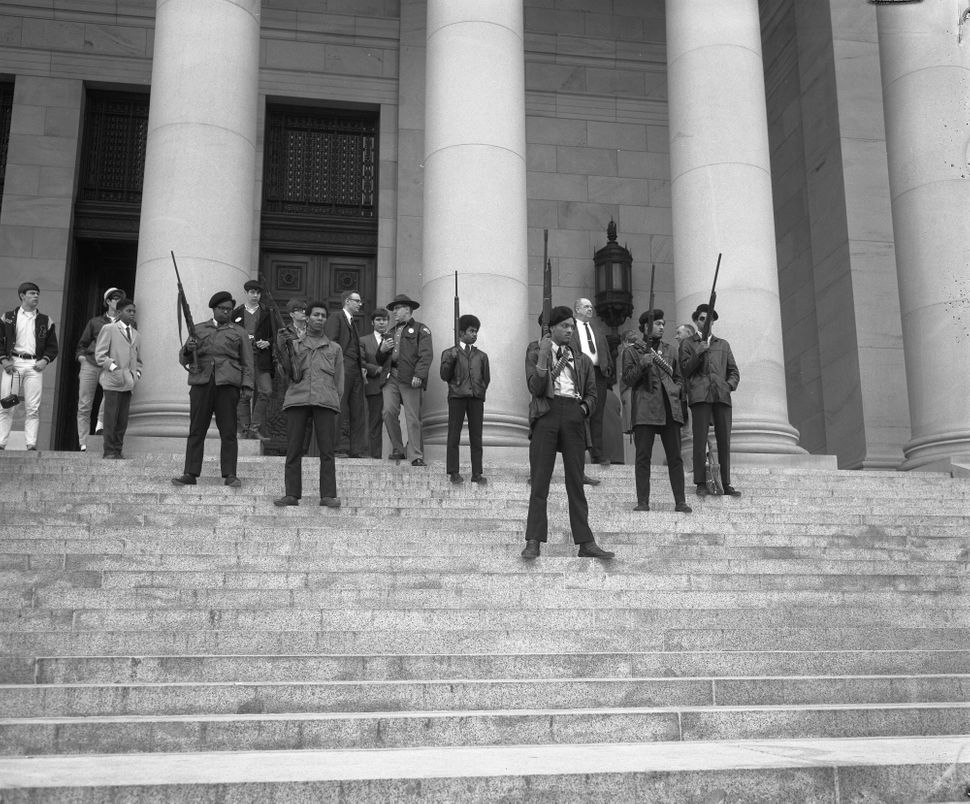 Armed members of the Seattle chapter of the Black Panther Party standing on the state capitol steps protesting a proposed law