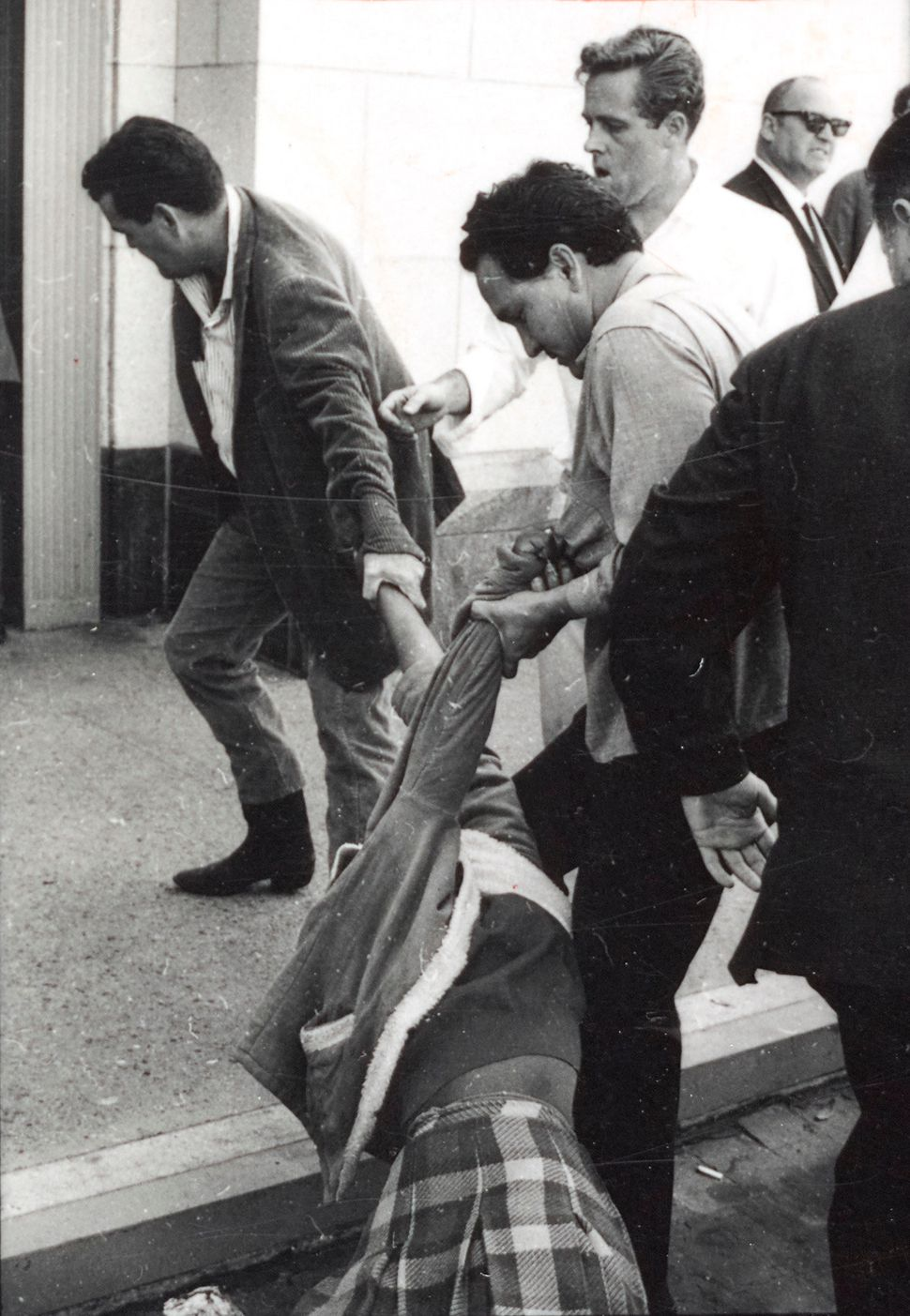 Protesters being physically removed during a demonstration against the shocking violence in Selma in March 1965. No clouds of