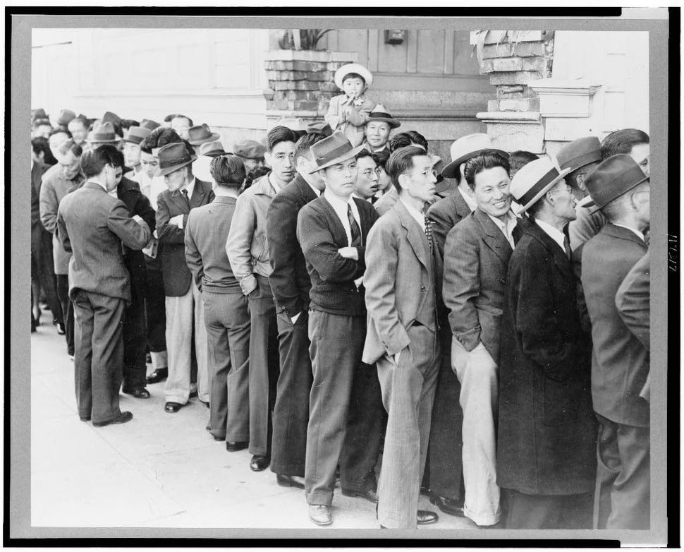 Residents of Japanese-Americans appearing at the Civil Control Station for registration in response to the Army's exclusion o