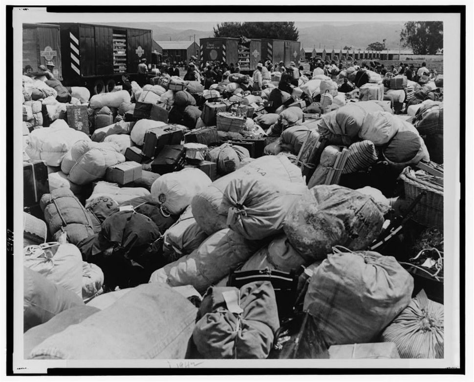 "Baggage belonging to prisoners of Japanese ancestry at an assembly center in Salinas, Calif., prior to a ""War Relocation"
