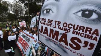 Thousands of demonstrators participate in the 'Ni una menos' (Not One Less) march through the center of Lima to the palace of justice holding banners and posters condemning gender violence and femicide - gender-based killings - on August 13, 2016.  / AFP / CRIS BOURONCLE        (Photo credit should read CRIS BOURONCLE/AFP/Getty Images)