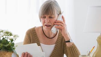 Senior woman looking at bills