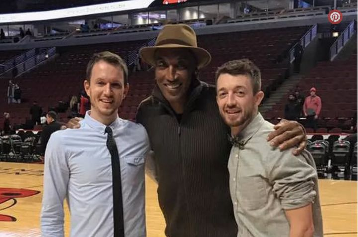 Scottie Pippen congratulated Michael Holtzman (left) and Jake Conrad, who got engaged at Thursday's Chicago Bulls game.