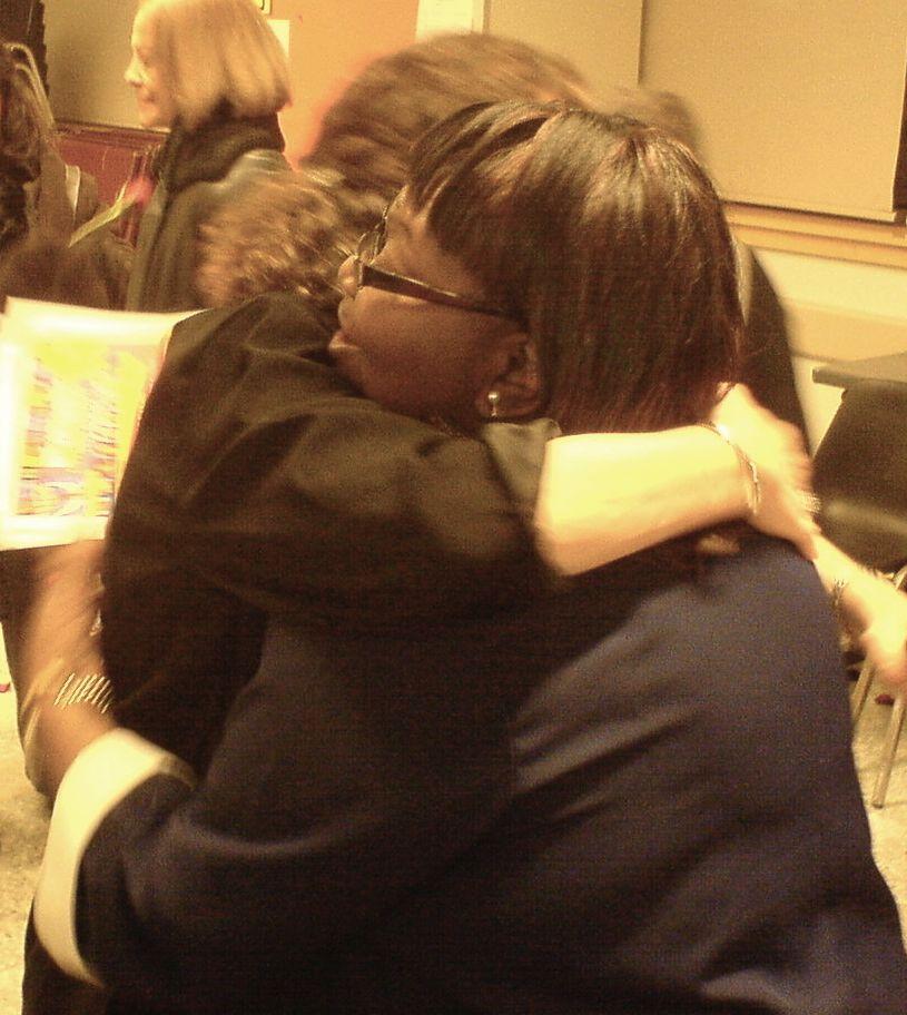A heartfelt hug at the close of a program